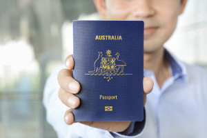 A man showing passport (of Australia)